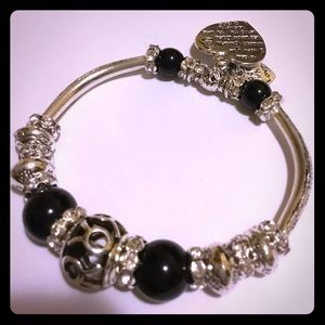 Black and silver bracelet with charms